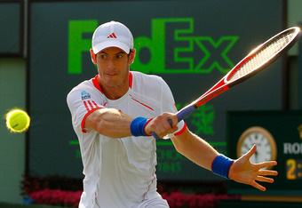 KEY BISCAYNE, FL - MARCH 28:  Andy Murray of Great Britain in action against Janko Tipsarevic of Serbia during the Sony Ericsson Open at the Crandon Park Tennis Center on March 28, 2012 in Key Biscayne, Florida.  (Photo by Mike Ehrmann/Getty Images)