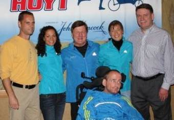 Captain Varinka Ensminger with husband Shane, Dick Hoyt, Uta Pippig, Jim Boyle, President of John Hancock, and Rick Hoyt (seated)