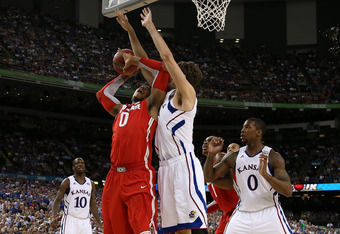 NEW ORLEANS, LA - MARCH 31:  Jared Sullinger #0 of the Ohio State Buckeyes looks to shoot over Jeff Withey #5 of the Kansas Jayhawks in the second half during the National Semifinal game of the 2012 NCAA Division I Men's Basketball Championship at the Mer