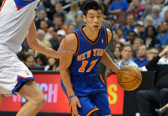 PHILADELPHIA, PA - MARCH 21: Jeremy Lin #17 of the New York Knicks drives around Spencer Hawes #00 of the Philadelphia 76ers at the Wells Fargo Center on March 21, 2012 in Philadelphia, Pennsylvania. NOTE TO USER: User expressly acknowledges and agrees th