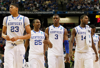 ATLANTA, GA - MARCH 25:  Anthony Davis #23, Marquis Teague #25, Terrence Jones #3 and Michael Kidd-Gilchrist #14 of the Kentucky Wildcats react during the first half against the Baylor Bears during the 2012 NCAA Men's Basketball South Regional Final at th