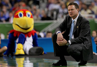 NEW ORLEANS, LA - MARCH 31:  Head coach Bill Self of the Kansas Jayhawks reacts in the first half as the Jayhawks mascot looks over at him as the Jayhawks take on the Ohio State Buckeyes during the National Semifinal game of the 2012 NCAA Division I Men's