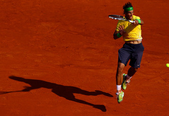 MONACO - APRIL 17:  Rafael Nadal of Spain plays a forehand to David Ferrer of Spain in the final during Day Eight of the ATP Masters Series Tennis at the Monte Carlo Country Club on April 17, 2011 in Monte Carlo, Monaco.  (Photo by Julian Finney/Getty Ima