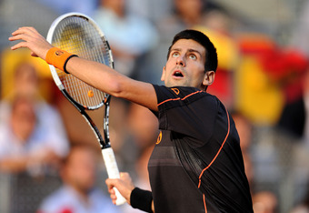MADRID, SPAIN - MAY 08:  Novak Djokovic of Serbia follows a high ball to Rafael Nadal of Spain in his final match during day eight of the Mutua Madrilena Madrid Open Tennis on May 8, 2011 in Madrid, Spain. Djokovic won his match in straight sets.  (Photo