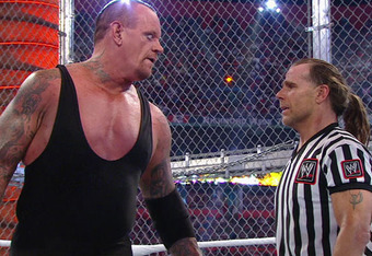 Shawn Michaels pleads with the Undertaker to stop.