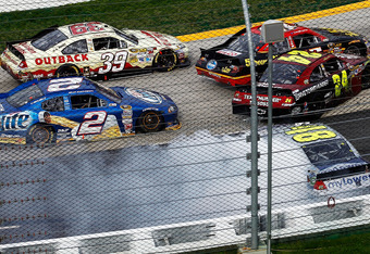 Jeff Gordon(24) and others crash on the ensuing restart following Reutimann's caution
