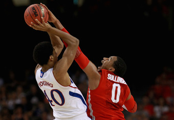 NEW ORLEANS, LA - MARCH 31:  Jared Sullinger #0 of the Ohio State Buckeyes blocks the shot of Kevin Young #40 of the Kansas Jayhawks in the first half during the National Semifinal game of the 2012 NCAA Division I Men's Basketball Championship at the Merc