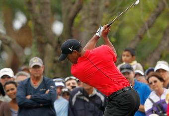 PALM BEACH GARDENS, FL - MARCH 04:  Tiger Woods hits his tee shot on the fourth hole during the final round of the Honda Classic at PGA National on March 4, 2012 in Palm Beach Gardens, Florida.  (Photo by Mike Ehrmann/Getty Images)