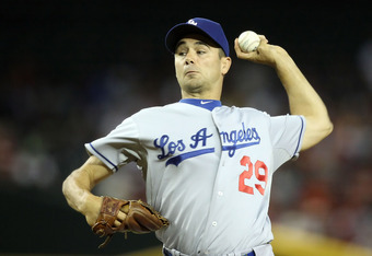 PHOENIX, AZ - SEPTEMBER 28:  Starting pitcher Ted Lilly #29 of the Los Angeles Dodgers pitches against the Arizona Diamondbacks during the Major League Baseball game at Chase Field on September 28, 2011 in Phoenix, Arizona.  (Photo by Christian Petersen/G
