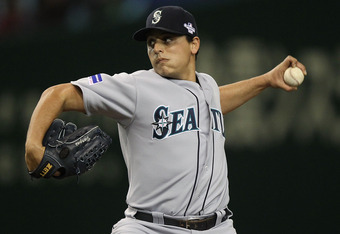 TOKYO, JAPAN - MARCH 29:  Jason Vargas #38 the Seattle Mariners pitches against the Oakland Athletics during the MLB Opening Series game two between the Seattle Mariners and Oakland Athletics at Tokyo Dome on March 29, 2012 in Tokyo, Japan.  (Photo by Chr