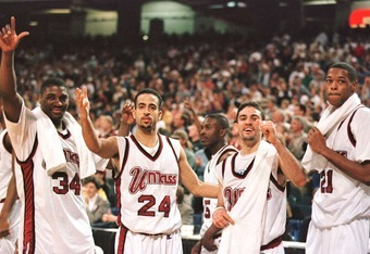23 Mar 1996: Tyrone Weeks #34, Carmelo Travieso #24, Edgar Padilla #12 and Marcus Camby #21 of the UMass Minutemen poses for a portrait while celebrating in the final seconds of the Minutemen''s 86-62 NCAA East Regional Championship victory over the Georg