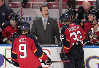 SUNRISE, FL - NOVEMBER 3: Head coach Kevin Dineen talks to Stephen Weiss #9 and Kris Versteeg #32 of the Florida Panthers during a break in action against the Chicago Blackhawks on November 3, 2011 at the BankAtlantic Center in Sunrise, Florida. The Black