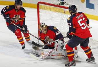 SUNRISE, FL - MARCH 13: Brian Campbell #51 and Jason Garrison #52 look on as goaltender Jose Theodore #60 of the Florida Panthers makes a save late in the third period against the Toronto Maple Leafs on March 13, 2012 at the BankAtlantic Center in Sunrise