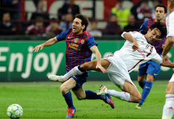 MILAN, ITALY - MARCH 28:  Alessandro Nesta (R) of AC Milan and Lionel Messi of Barcelona compete for the ball during the UEFA Champions League quarter final first leg match between AC Milan and Barcelona at Stadio Giuseppe Meazza on March 28, 2012 in Mila
