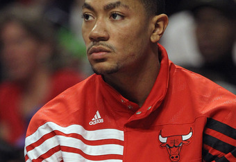 CHICAGO, IL - MARCH 24:  Derrick Rose #1 of the Chicago Bulls watches from the bench as his teammates take on the Toronto Raptors at the United Center on March 24, 2012 in Chicago, Illinois. The Bulls defeated the Raptors 102-101 in overtime. NOTE TO USER