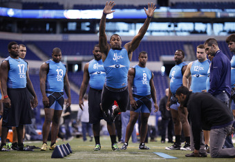 INDIANAPOLIS, IN - FEBRUARY 27: Defensive lineman Andre Branch of Clemson participates in the broad jump during the 2012 NFL Combine at Lucas Oil Stadium on February 27, 2012 in Indianapolis, Indiana. (Photo by Joe Robbins/Getty Images)