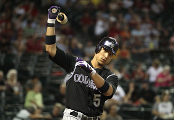PHOENIX, AZ - AUGUST 29:  Carlos Gonzalez #5 of the Colorado Rockies during the Major League Baseball game against the Arizona Diamondbacks at Chase Field on August 29, 2011 in Phoenix, Arizona.  The Diamondbacks defeated the Rockies 5-1.  (Photo by Chris