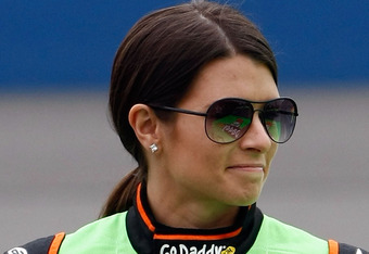 FONTANA, CA - MARCH 24:  Danica Patrick, driver of the #7 GoDaddy.com Chevrolet, walks on the grid during qualifying for the NASCAR Nationwide Series Royal Purple 300 at Auto Club Speedway on March 24, 2012 in Fontana, California.  (Photo by Jonathan Ferr