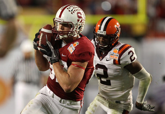 MIAMI, FL - JANUARY 03: Coby Fleener #82 of the Stanford Cardinal scores a 58-yard tochdown reception in the fourth quarter against Davon Morgan #2 of the Virginia Tech Hokies during the 2011 Discover Orange Bowl at Sun Life Stadium on January 3, 2011 in