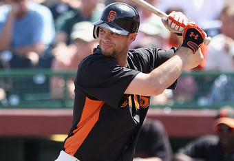 SCOTTSDALE, AZ - MARCH 27:  Brandon Belt #9 of the San Francisco Giants bats against the Los Angeles Angels of Anaheim during the spring training game at Scottsdale Stadium on March 27, 2012 in Scottsdale, Arizona.  (Photo by Christian Petersen/Getty Imag