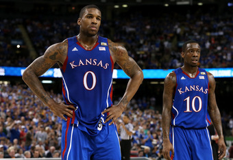 NEW ORLEANS, LA - APRIL 02:  Thomas Robinson #0 and Tyshawn Taylor #10 of the Kansas Jayhawks look on in the first half while taking on the Kentucky Wildcats in the National Championship Game of the 2012 NCAA Division I Men's Basketball Tournament at the