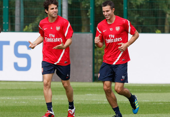 ST ALBANS, ENGLAND - AUGUST 05: Cesc Fabregas (L) and Robin Van Persie of Arsenal in action during a training session at London Colney on August 5, 2011 in St Albans, England.  (Photo by Tom Dulat/Getty Images)