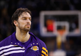 OAKLAND, CA - MARCH 27:  Pau Gasol #16 of the Los Angeles Lakers stands for the National Anthem before their game against the Golden State Warriors at Oracle Arena on March 27, 2012 in Oakland, California. NOTE TO USER: User expressly acknowledges and agr