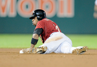 WASHINGTON, DC - SEPTEMBER 09:  Jason Bourgeois #11 of the Houston Astros steals second base against the Washington Nationals at Nationals Park on September 9, 2011 in Washington, DC.  (Photo by Greg Fiume/Getty Images)