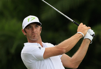 MIAMI, FL - MARCH 08:  Dustin Johnson watches his tee shot on the 15th hole during first round of the World Golf Championships-Cadillac Championship on the TPC Blue Monster at Doral Golf Resort And Spa on March 8, 2012 in Miami, Florida.  (Photo by Scott