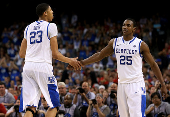 NEW ORLEANS, LA - MARCH 31:  Anthony Davis #23 of the Kentucky Wildcats give teammate Marquis Teague #25 a five late in the second half against the Louisville Cardinals during the National Semifinal game of the 2012 NCAA Division I Men's Basketball Champi