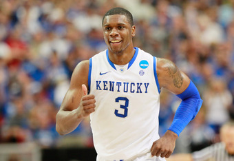 ATLANTA, GA - MARCH 25:  Terrence Jones #3 of the Kentucky Wildcats celebrates against the Baylor Bears in the first half during the 2012 NCAA Men's Basketball South Regional Final at the Georgia Dome on March 25, 2012 in Atlanta, Georgia.  (Photo by Kevi
