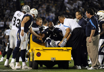 SAN DIEGO, CA - NOVEMBER 10:  Offensive lineman Marcus McNeill #73 of the San Diego Chargers is carted off the field due to injury as quarterback  Philip Rivers #17 and  Tommy Kelly #93 of the Oakland Raiders give him a five in the first  at Qualcomm Stad