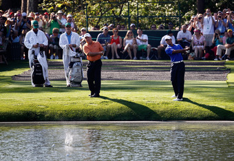 AUGUSTA, GA - APRIL 02:  Tiger Woods (R) and Mark O'Meara skip balls over the water during a practice round prior to the start of the 2012 Masters Tournament at Augusta National Golf Club on April 2, 2012 in Augusta, Georgia.  (Photo by Streeter Lecka/Get