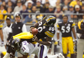 4 Nov 2001 : Plaxico Burress #80 of the Pittsburgh Steelers goes airborne as he is tackled by Chris McAllister #21 of the Baltimore Ravens during the game at Heinz Field in Pittsburgh, Pennsylvania. The Ravens won 13-10. DIGITAL IMAGE. Mandatory Credit: J