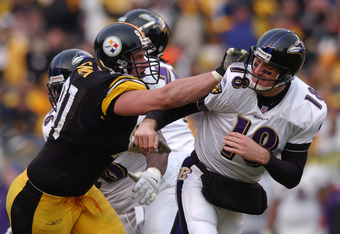 20 Jan 2002:  Aaron Smith #91 of the Pittsburgh Steelers follows through on a hit to Elvis Grbac #18 of the Baltimore Ravens as the Steelers defeated the Ravens 27-10 in AFC Playoff action at Heinz Field in Pittsburgh, Pennsylvania. DIGITAL IMAGE. Mandato