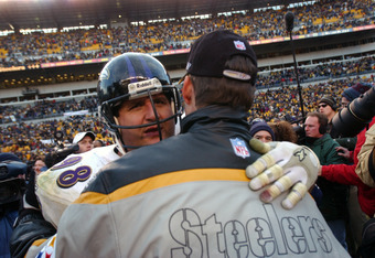 20 Jan 2002 : Casey Hampton #98 of the Baltimore Ravens congratulates head coach Bill Cowher of the Pittsburgh Steelers after the AFC divisional playoff game at Heinz Field in Pittsburgh, Pennsylvania. The Steelers won 27-10. DIGITAL IMAGE. Mandatory Cred
