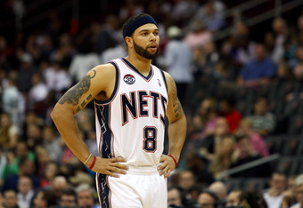 NEWARK, NJ - MARCH 19:  Deron Williams #8 of the New Jersey Nets looks on against the Cleveland Cavaliers at Prudential Center on March 19, 2012 in Newark, New Jersey.  NOTE TO USER: User expressly acknowledges and agrees that, by downloading and or using