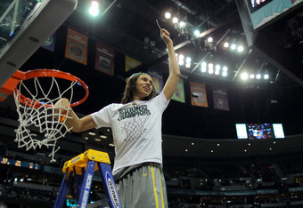 DENVER, CO - APRIL 03:  Brittney Griner #42 of the Baylor Bears celebrates after she cuts down a piece of the net after they won 80-61 against the Notre Dame Fighting Irish during the National Final game of the 2012 NCAA Division I Women's Basketball Cham