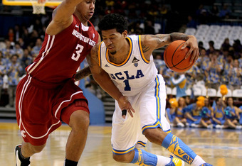 LOS ANGELES, CA - MARCH 01:  Tyler Lamb #1 of the UCLA Bruins drives against Davonte Lacy #3 of the Washington State Cougars at the LA Sports Arena on March 1, 2012 in Los Angeles, California.  UCLA won 78-46.  (Photo by Stephen Dunn/Getty Images)