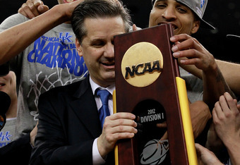 NEW ORLEANS, LA - APRIL 02:  Head coach John Calipari celebrates with his team after the Wildcats defeat the Kansas Jayhawks 67-59 in the National Championship Game of the 2012 NCAA Division I Men's Basketball Tournament at the Mercedes-Benz Superdome on