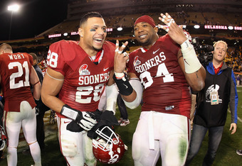 TEMPE, AZ - DECEMBER 30:  (L-R) Travis Lewis #28 and Frank Alexander #84 of the Oklahoma Sooners celebrate after defeating the Iowa Hawkeyes in the Insight Bowl at Sun Devil Stadium on December 30, 2011 in Tempe, Arizona. The Sooners defeated the Hawkeyes