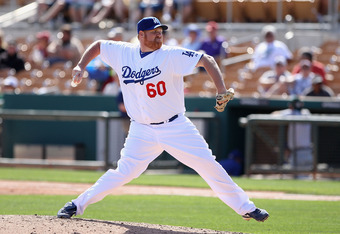 GLENDALE, AZ - MARCH 08:  Relief pitcher Todd Coffey #60 of the Los Angeles Dodgers pitches against the Oakland Athletics during the spring training game at Camelback Ranch on March 8, 2012 in Glendale, Arizona.  (Photo by Christian Petersen/Getty Images)