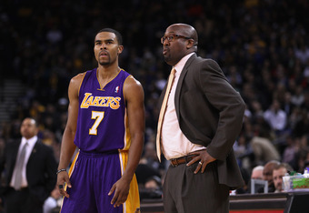 OAKLAND, CA - MARCH 27:  Ramon Sessions #7 of the Los Angeles Lakers talks to head coach Mike Brown during their game against the Golden State Warriors at Oracle Arena on March 27, 2012 in Oakland, California. NOTE TO USER: User expressly acknowledges and