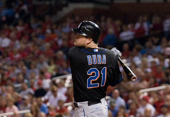 ST. LOUIS, MO - SEPTEMBER 20: Lucas Duda #21 of the New York Mets hits a one-run double against the St. Louis Cardinals at Busch Stadium on September 20, 2011 in St. Louis, Missouri.  (Photo by Jeff Curry/Getty Images)