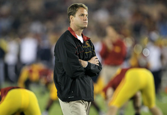 LOS ANGELES, CA - NOVEMBER 26:  Head coach Lane Kiffin of the USC Trojans watches his team warm up for the game with the UCLA Bruins at the Los Angeles Memorial Coliseum on November 26, 2011 in Los Angeles, California.  (Photo by Stephen Dunn/Getty Images