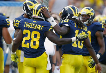 ANN ARBOR, MI - SEPTEMBER 03: Denard Robinson #16 of the Michigan Wolverines celebrate a second quarter touchdown with Fitzgerald Toussaint #28 while playing the Western Michigan Broncos at Michigan Stadium on September 3, 2010 in Ann Arbor, Michigan. (Ph