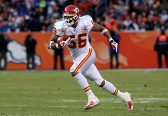 DENVER - JANUARY 03:  Linebacker Derrick Johnson #56 of the Kansas City Chiefs intercepts a pass by Kyle Orton of the Denver Broncos and returns it 45 yards for a touchdown to give the Chiefs a 27-17 lead in the third quarter during NFL action at Invesco