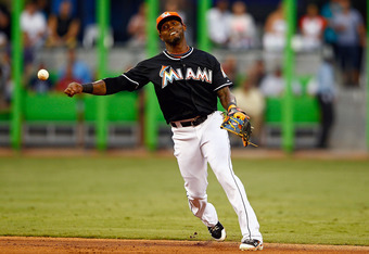 MIAMI, FL - APRIL 02:  Jose Reyes #7 of the Miami Marlins makes a throw to first during a preseason game against the New York Yankees at Marlins Park on April 2, 2012 in Miami, Florida.  (Photo by Mike Ehrmann/Getty Images)