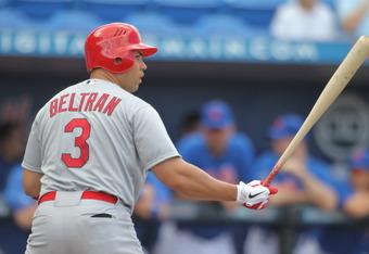 PORT ST. LUCIE, FL - MARCH 13:  Carlos Beltran #3 of the St. Louis Cardinals hits against the New York Mets at Digital Domain Park on March 13, 2012 in Port St. Lucie, Florida.  (Photo by Marc Serota/Getty Images)