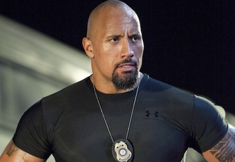 How much will Dwayne Johnson, the movie star, get in the way of The Rock, the wrestler.